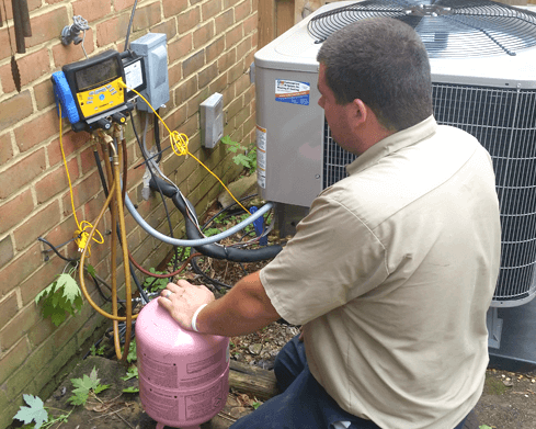 Tech repairing a heat pump