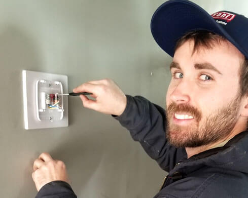 Tech working on a thermostat